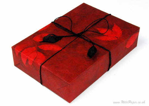 Gift wrapped present in Romantic Red paper